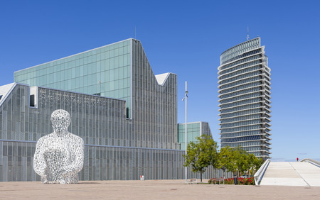 ZARAGOZA,SPAIN-SEPTEMBER 17,2015: Modern architecture, buildings in Expo 2008 site, Tower, Torre del Agua and Congress Palace and sculpture by Jaume Plensa, Zaragoza, Spain.