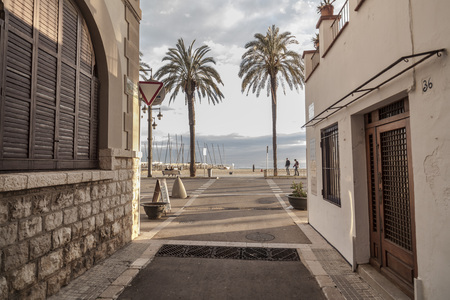 SITGES,SPAIN-FEBRUARY 26,2015:Street in catalan village of Sitges, province Barcelona, Catalonia, Spain.