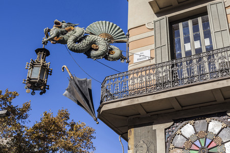 BARCELONA,SPAIN-NOVEMBER 11,2015: Casa Bruno Cuadros, old umbrella shop, artistic building in Las Ramblas, modernist style, highlights the dragon of orientalist influence, Pla de la Boqueria, Ciutat Vella district, La Rambla, Barcelona.