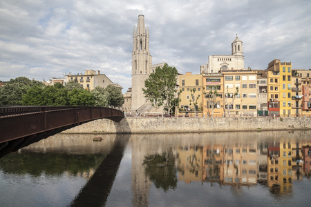 GIRONA,SPAIN-JUNE 9,2016: City view, colored houses over river, Girona, Catalonia.