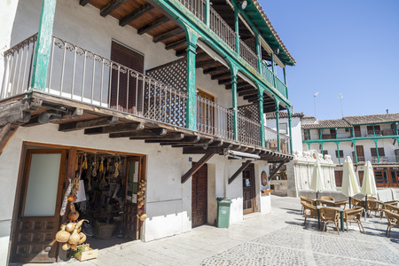 CHINCHON,SPAIN-JULY 24,2015: Square, Plaza Mayor, wooden balconies and shop in the village of Chinchon, province Madrid, Spain. Editoriali