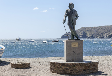 CADAQUES,SPAIN-MAY 21,2015: Beach view and sculpture Salvador Dali by sculptor Ros Sabate, in Cadaques,village of Costa Brava. Editorial