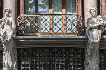OLOT,SPAIN-MAY 12,2015: Detail facade building, two caryatid and balcony of Casa Sola Morales or Casa Firal, modernist building by Lluis Domenech i Montaner,Catalonia. Editorial