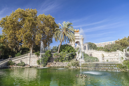 BARCELONA,SPAIN-OCTOBER 26,2011: Park, Parc de la Ciutadella. Pond, waterfall and monument, by Josep Fontsere. Barcelona.