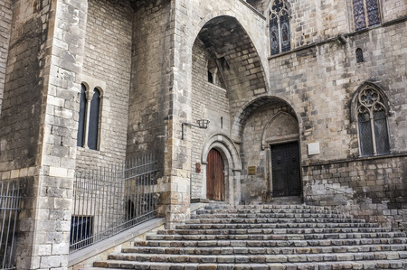 BARCELONA,SPAIN-SEPTEMBER 5,2011: Ancient architecture, Main entrance to Palace, Palau Reial Major. Entrance to chapel Santa Agata and Salo del Tinell, Plaza del Rei, Gothic quarter, Barcelona.