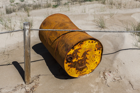 the dorada: Rusty drum by the beach. Stock Photo