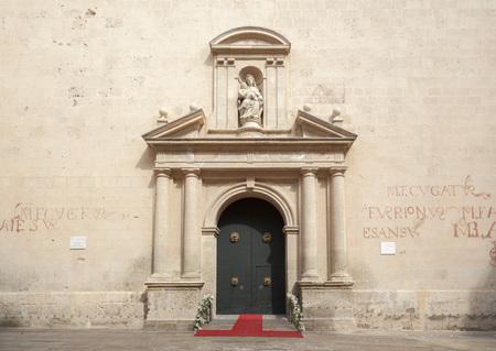 ALICANTE,SPAIN-SEPTEMBER 23,2017:Door entrance co-cathedral of Saint Nicholas of Bari, Renaissance style,Alicante,Spain.