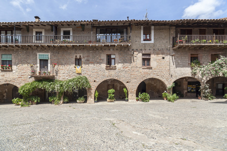 SANTA PAU,SPAIN-MAY 9,2017:Main square in ancient village of Santa Pau,Catalonia,Spain.