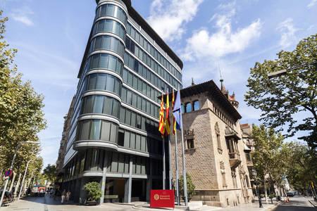 BARCELONA,SPAIN-AUGUST 13,2017:Modern and ancient architecture,Can Serra palace by Josep Puig i Cadafalch and annex building by F.Correa and A.Mila,Eixample district,hosts Diputacio of Barcelona.