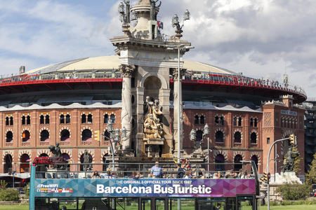 BARCELONA, SPAIN-SEPTEMBER 16,2017: Street view, square, spanish plaza, monument fountain, old bullring arenas and touristic bus, Barcelona.
