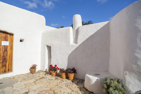 Ancient house and windmill Can Planetes, nowadays is cultural and ethnographic center.Santa Eularia des Riu, Ibiza, Spain.