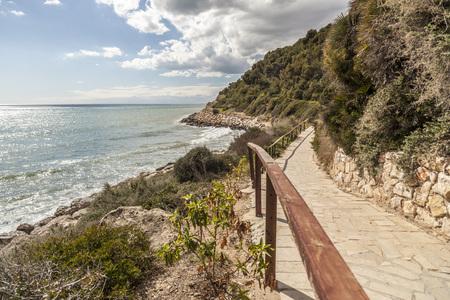 Footpath, Cami de Ronda close to Mediterranean sea in Roda de Bera, Costa Dorada, Catalonia, Spain. Stock Photo