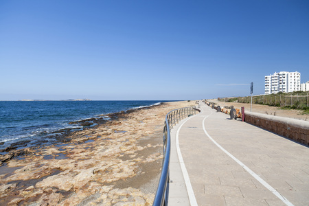 Promenade close to mediterranean sea, town of Sant Antoni, Ibiza island,Spain.