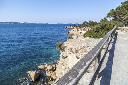 Coastal route, maritime promenade, town of Sant Antoni, Ibiza Island,Spain.