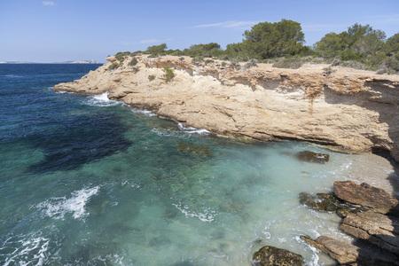 Mediterranean sea, coastal view, rock formation, town of Sant Antoni, Ibiza Island,Spain.