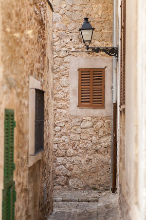 Narrow street in village of Valldemossa, Majorca island, Spain.