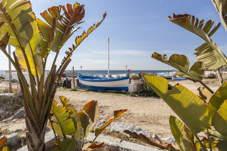 Fishing boats on sand of beach in Maresme area, village of Vilassar de Mar,Catalonia. Redakční