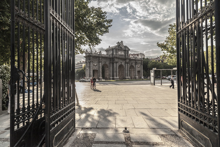 MADRID,SPAIN-JULY 23,2015: Door entrance to park, parque del retiro and Puerta de Alcala, Madrid. Editoriali