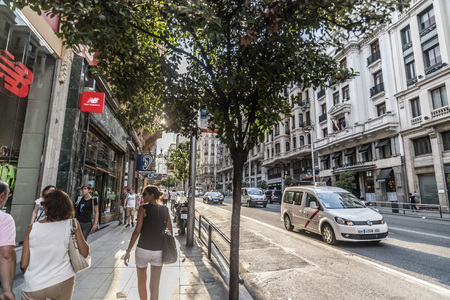 MADRID,SPAIN-JULY 23,2015: Street scene view of famous Gran Via in Madrid.