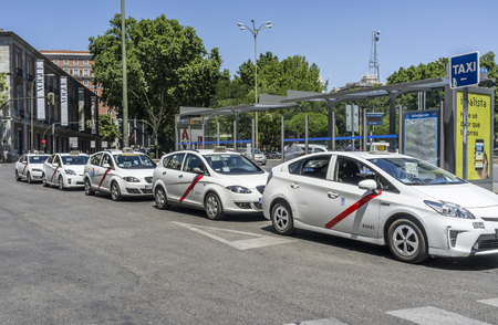 MADRID,SPAIN-JULY 25,2015: Row of taxis, street city center of Madrid.