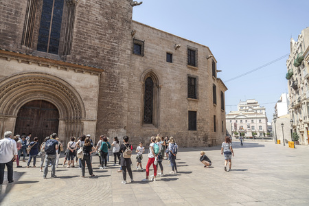 VALENCIA,SPAIN-MAY 9,2018: Group tourists front cathedral door, Valencia.