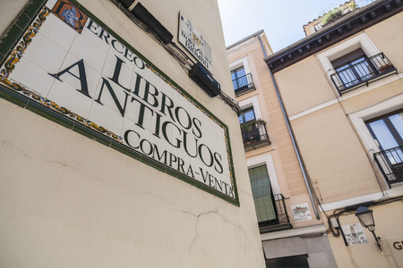 Ancient book store sign, old books, facade street, Madrid. Editoriali