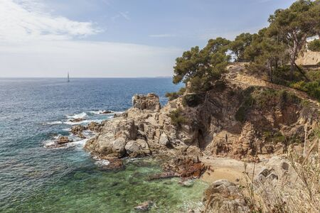 Mediterranean coast and cliffs in Lloret de Mar, Costa Brava, Catalonia, Spain. Archivio Fotografico