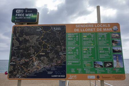 LLORET DE MAR,SPAIN-MARCH 11,2019: Trekking map in maritime promenade of Lloret de Mar, Costa Brava. Editoriali