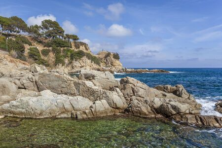 Mediterranean coast and cliffs in Lloret  Mar, Costa Brava, Catalonia, Spain.