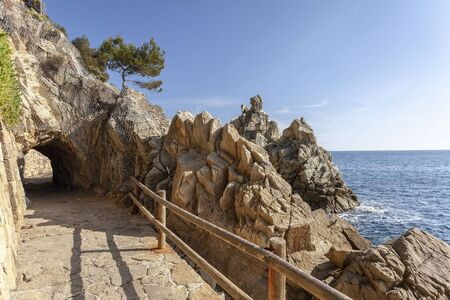 Stone footpath in Fenals beach, Lloret  Mar, Costa Brava, Catalonia, Spain. Archivio Fotografico