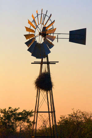 Windmill in Sunrise with Nest Stock Photo