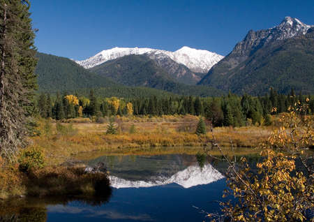 Cabinets mountains in fall capped with Snow with reflection