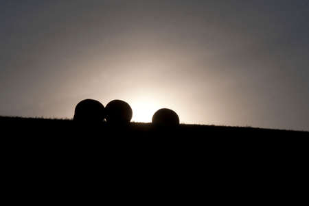 Bales of Hay in Setting Sun  Stock Photo