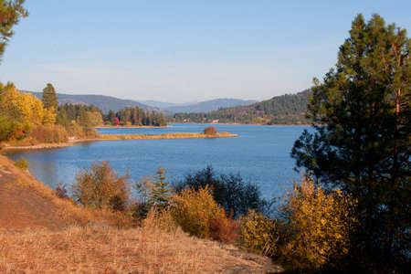 Pend Oreille River decked out in Fall Colors Stock Photo - 23818930