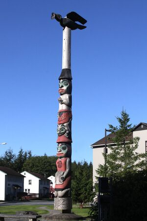 A Raven Totem Pole has been intricately carved by Alaskan natives