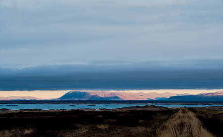 A gigantic cloud covers almost the entire sky except the horizon in Iceland