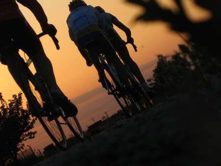 cycling silhouette: Cycling in sunset.