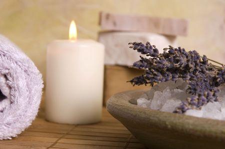 aromatherapy. lavender bath items. towel, salt, soap, flwers, candles. spa photo