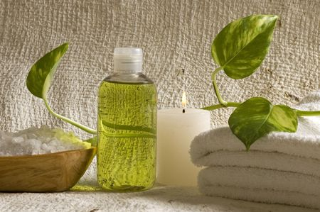 aroma therapy objects. bottle of esential oil, candles, bath-salt, towels. photo