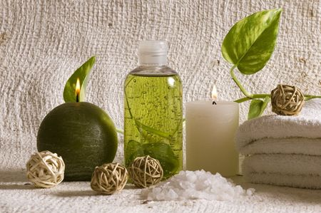 aroma therapy objects. bottle of esential aroma liquid, candle, towels, bath - salt photo