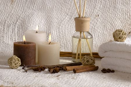 aroma therapy objects. bottle of esential oil, candles, bath-salt, towels, coffee, vanilla, anise - stars photo