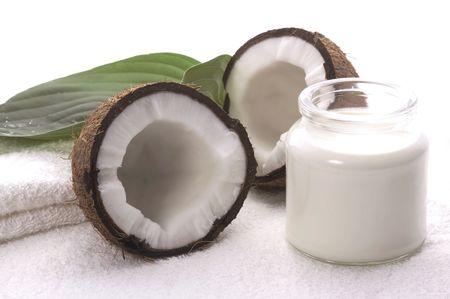 coco bath items. coconut, milk, towel. white spa photo