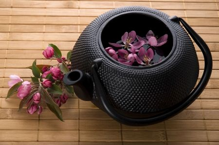 teapot with a fresh flowers on the bamboo tray Stock Photo - 3450308