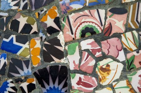 Antoni Gaudí mosaic work on the main terrace at Park Güell (1914)- Barcelona - Spain. photo