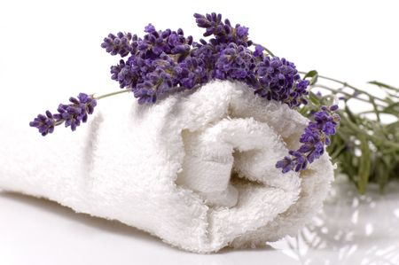 lavender coloured: lavender bath items. salt, towel, and fresh flower