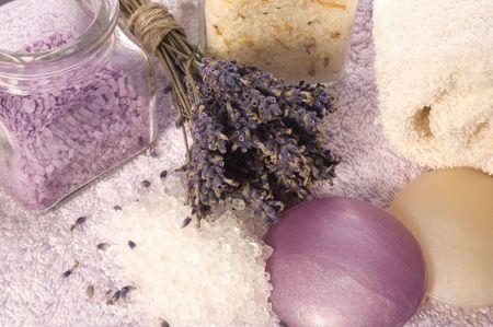 lavender bath items. salt, towels, soaps and flowers photo