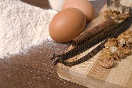 cooking ingredients. flour, eggs, sugar, spices - cinnamon, vanilla and nuts Stock Photo - 3450307