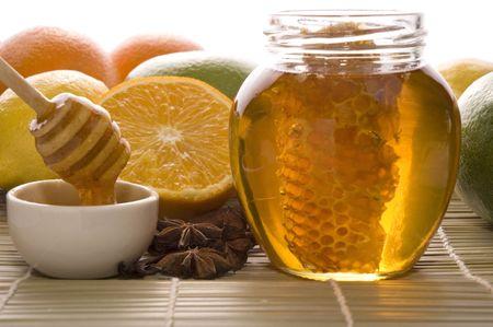 fresh honey with honeycomb, lemons, oranges, cinnamon, vanilla, anise star Stock Photo - 3457411