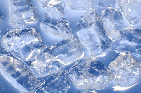 ice cube: macro of ice cubes in a blue bin