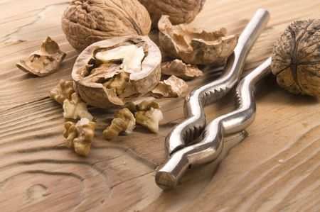 walnuts and nutcracker on the old wood Stock Photo - 3457686